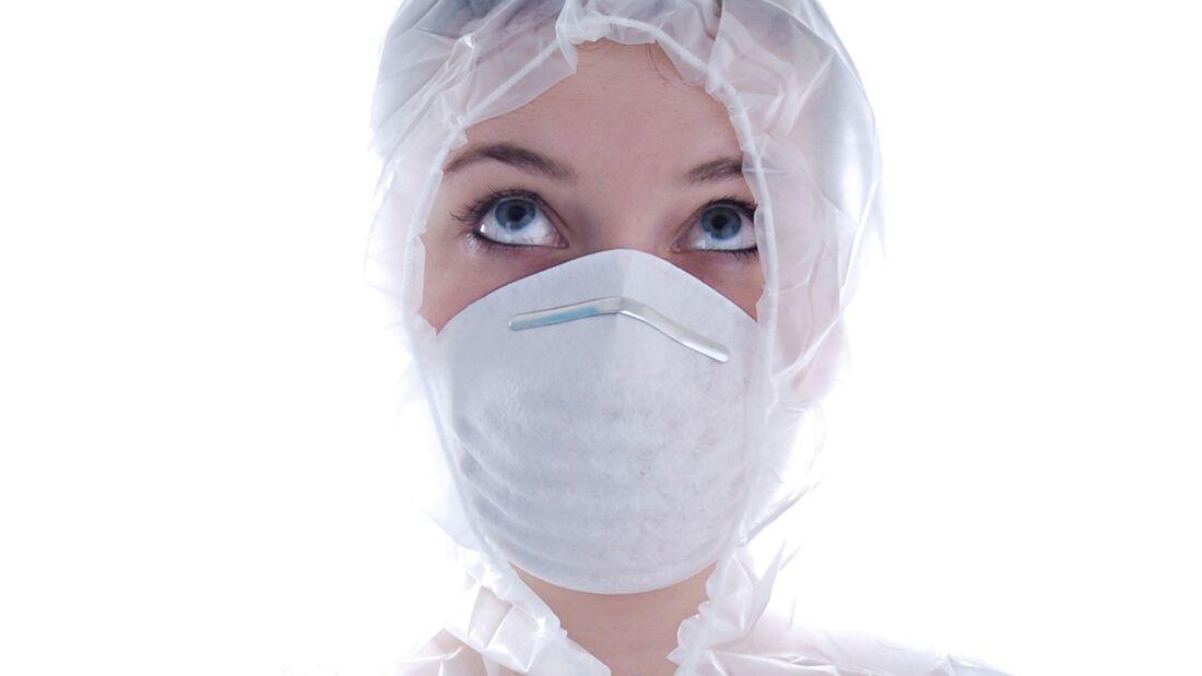 AL-illu- Teaser gegen Erkältung - Frau mit Mundschutz