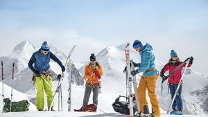 Backcountry skiers getting gear ready